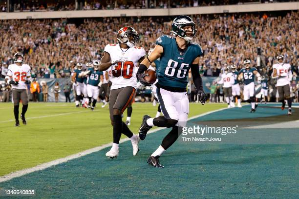 Tight end Zach Ertz of the Philadelphia Eagles catches a first quarter touchdown pass in front of defensive back Dee Delaney of the Tampa Bay...