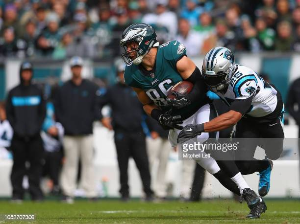 Tight end Zach Ertz of the Philadelphia Eagles catches a firstdown pass as he tackled by strong safety Eric Reid of the Carolina Panthers during the...