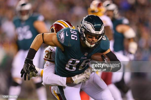 Tight end Zach Ertz of the Philadelphia Eagles catches a pass and is tackled by cornerback Fabian Moreau of the Washington Redskins during the third...
