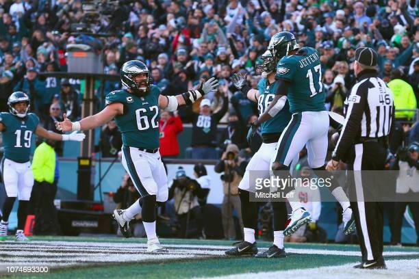 Tight end Zach Ertz of the Philadelphia Eagles celebrates his touchdown with teammates wide receiver Alshon Jeffery and center Jason Kelce against...