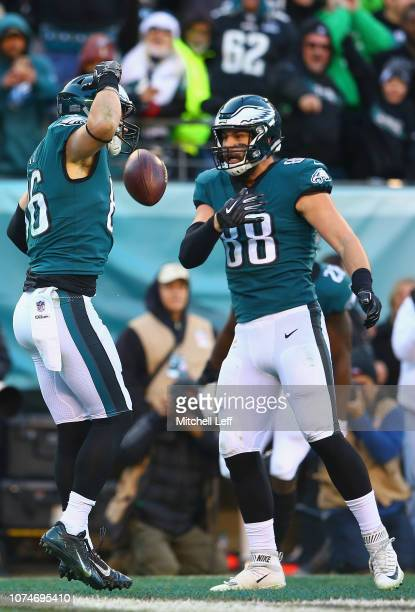 Tight end Zach Ertz of the Philadelphia Eagles celebrates his touchdown with tight end Dallas Goedert against the Houston Texans during the fourth...