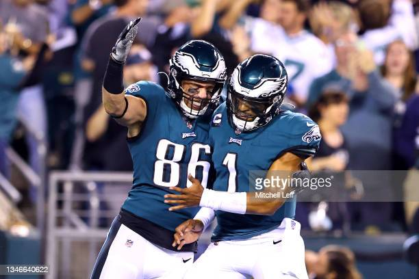 Tight end Zach Ertz of the Philadelphia Eagles celebrates with quarterback Jalen Hurts after catching a first quarter touchdown pass against the...