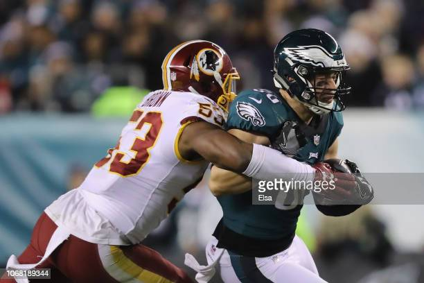 Tight end Zach Ertz of the Philadelphia Eagles makes a catch as he is tackled by linebacker Zach Brown of the Washington Redskins during the third...