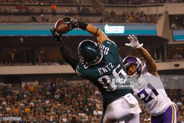 Tight end Zach Ertz of the Philadelphia Eagles makes a touchdown catch against cornerback Mike Hughes of the Minnesota Vikings during the fourth...