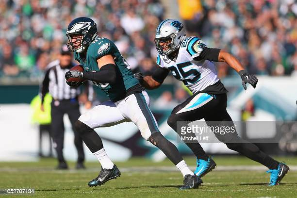 Tight end Zach Ertz of the Philadelphia Eagles runs for a touchdown against strong safety Eric Reid of the Carolina Panthers during the third quarter...