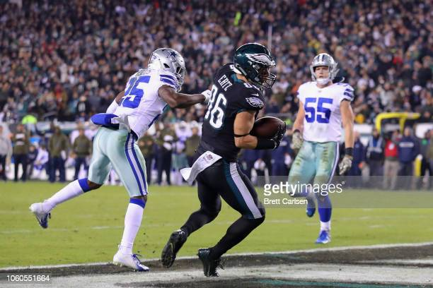 Tight end Zach Ertz of the Philadelphia Eagles scores against free safety Xavier Woods of the Dallas Cowboys during the third quarter at Lincoln...