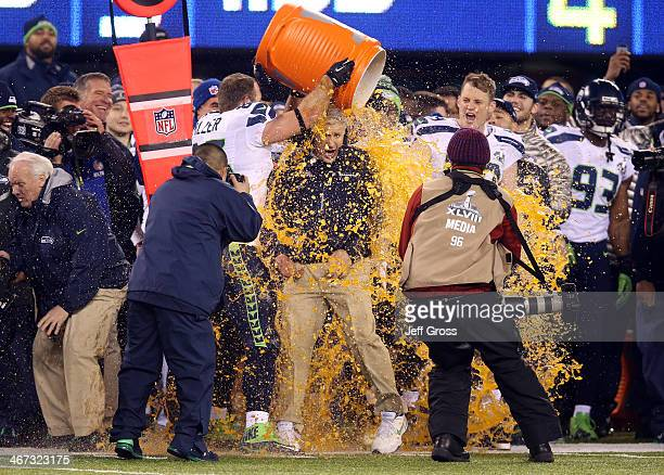 Tight end Zach Miller of the Seattle Seahawks dumps Gatorade on head coach Pete Carroll in the fourth quarter of Super Bowl XLVIII against the Denver...
