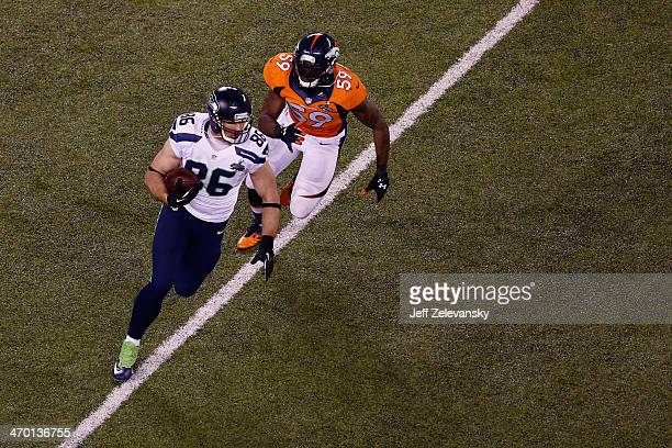 Tight end Zach Miller of the Seattle Seahawks tries to avoid the tackle of outside linebacker Danny Trevathan of the Denver Broncos during Super Bowl...