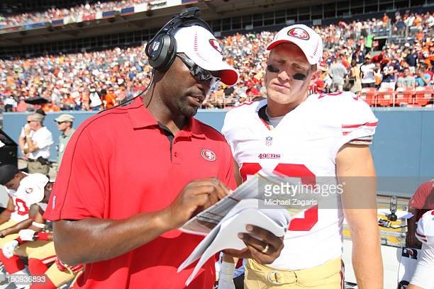Tight Ends Coach Reggie Davis of the San Francisco 49ers talks with Konrad Reuland during the game against the Denver Broncos at Sports Authority...