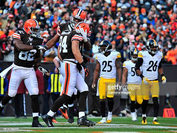 Tight ends Jordan Cameron Alex Smith and Benjamin Watson of the Cleveland Browns celebrate after a touchdown during a game against the Pittsburgh...