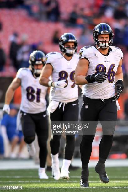 Tight ends Nick Boyle Mark Andrews and Hayden Hurst of the Baltimore Ravens run onto the field prior to a game against the Cleveland Browns on...