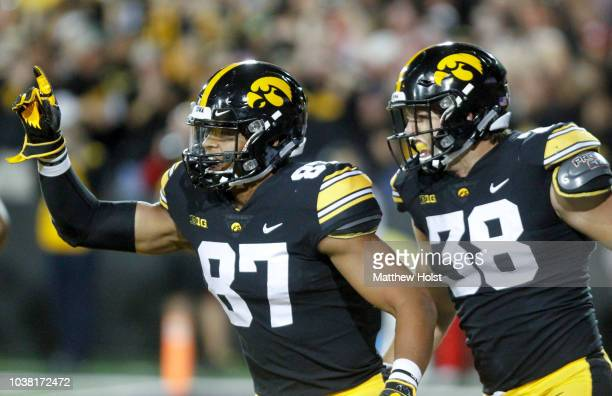 Tight ends Noah Fant and TJ Hockenson of the Iowa Hawkeyes celebrate a touchdown during the first half against the Wisconsin Badgers on September 22...