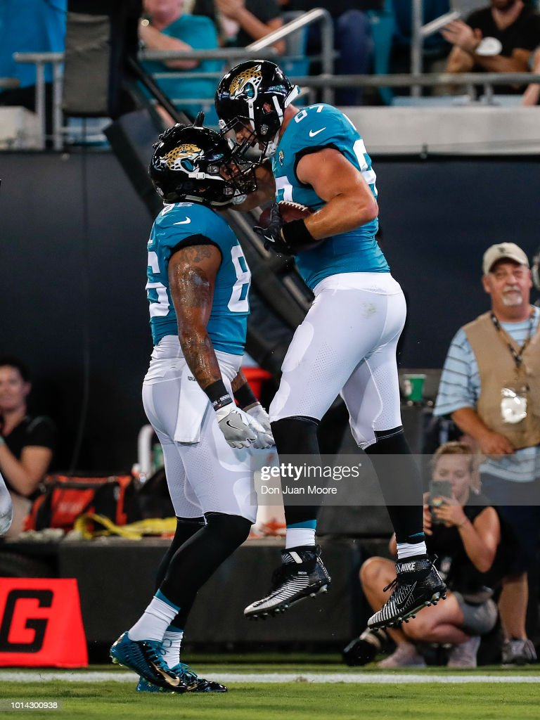Tight Ends Scott Orndoff celebrates with David Grinnages #86 of the Jacksonville Jaguars during a preseason game against the New Orleans Saints at TIAA Bank Field on August 9, 2018 in Jacksonville, Florida. The Saints defeated the Jaguars 24 to 20.