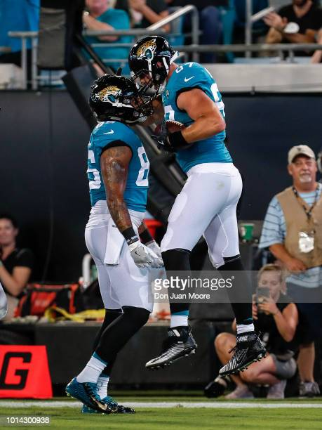 Tight Ends Scott Orndoff celebrates with David Grinnages of the Jacksonville Jaguars during a preseason game against the New Orleans Saints at TIAA...
