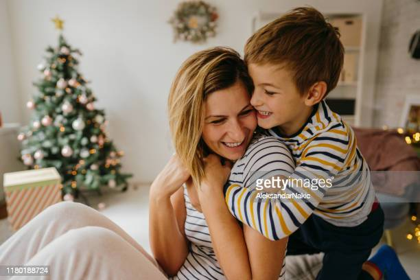 tight hug for my mom - december stock pictures, royalty-free photos & images