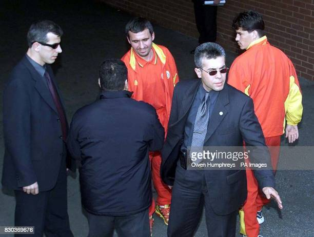 Tight security surrounds members of Turkish side Galatasaray at Leeds United's Eland Road ahead of their return UEFA Cup football match against Leeds...