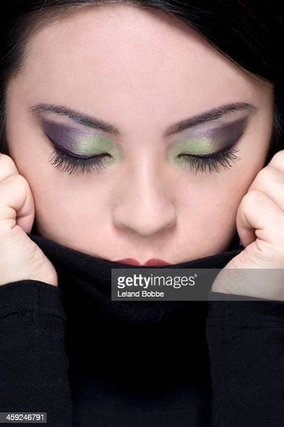 Tight shot of Asian woman with eyes closed