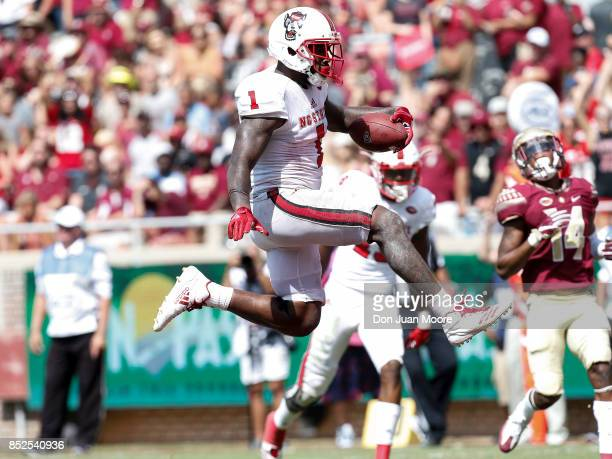 Tightend Jaylen Samuels of the North Carolina State Wolfpack leaps in the air after making a touchdown during the game against the Florida State...