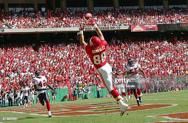 Tight-End Tony Gonzalez of the Kansas City Chiefs goes up to catch a touchdown pass during the 1st half of their NFL game on September 26, 2004 at...