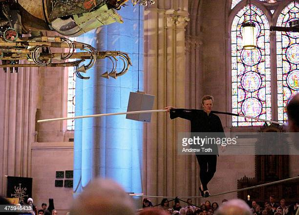 A tightrope performance by Artist Philippe Petit during Phoenix Xu Bing At The Cathedral Press Preview at The Cathedral Church of St John the Divine...