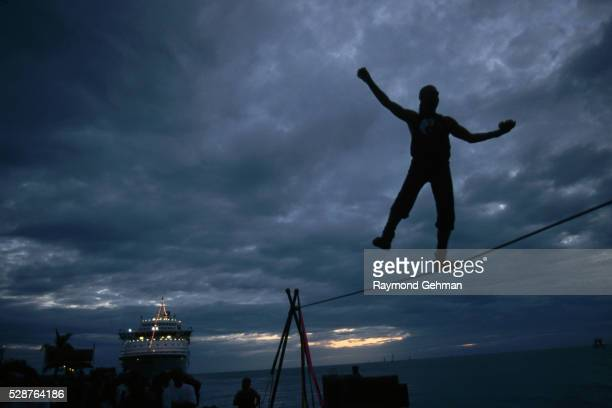 Tightrope Walker Along Gulf of Mexico