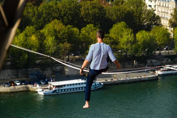 FRA: Tightrope Walker Nathan Paulin Traverses A SlackLine Between The Eiffel Tower And The Trocadero Square