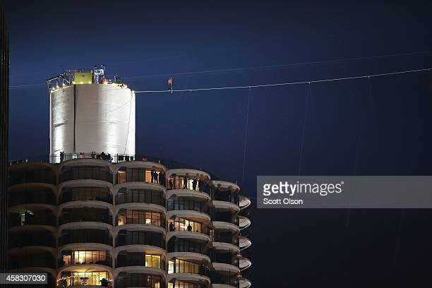 Tightrope walker Nik Wallenda starts out on his wire walk from Marina City's west tower to the top of the 671foottall Leo Burnett building on...