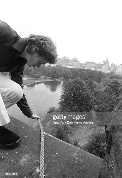 Tightrope walker Philippe Petit checks the tension of the cable atop Belvedere Castle Tower that he will walk on tonight in Central Park