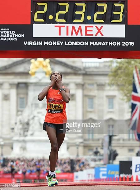 Tigist Tufa of Ethiopia celebrates after winning Women's race during the Virgin Money London Marathon on April 26, 2015 in London, England.