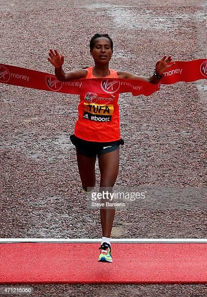 Tigist Tufa of Ethiopia crosses the finish line to win the Women's race during the Virgin Money London Marathon on April 26, 2015 in London, England.