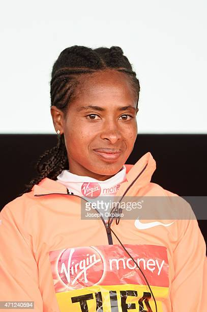 Tigist Tufa winner of the Elite Women division answers questions at a press conference after her race during the London Marathon on April 26, 2015 in...