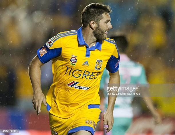 Tigres' Andre Pierre Gignac celebrates after scoring against Santos during their 2015 Mexican Apertura tournament football match at the Universitario...