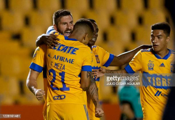 Tigres' Andre Pierre Gignac celebrates with teammates after scoring against Pumas during a Mexican Apertura 2020 football tournament match at the...