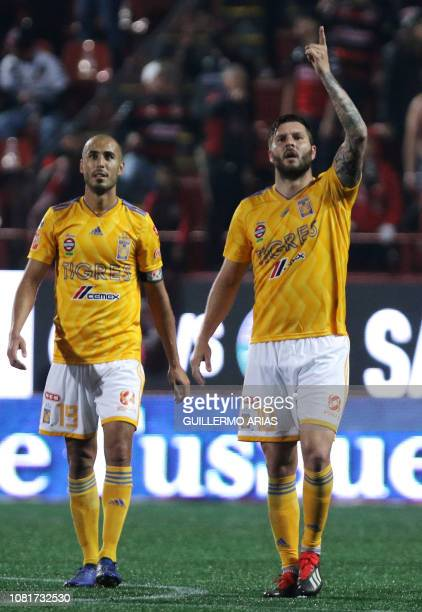 Tigres' AndrePierre Gignac celebrates with Guido Pizarro after scoring a goal during the Mexican Clausura 2019 tournament football match between Club...
