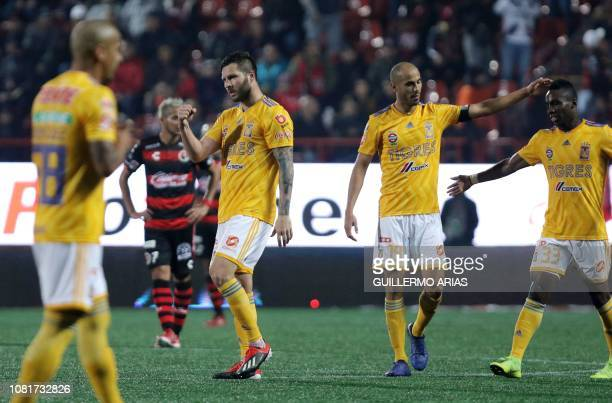 Tigres' AndrePierre Gignac celebrates with teammates Guido Pizarro and Julian Quinones after scoring during the Mexican Clausura 2019 tournament...