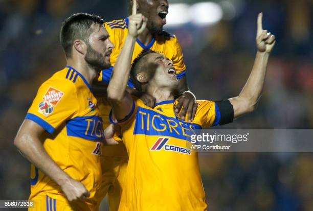 Tigres' Anselmo Vendrechovski celebrates with teammates after scoring against Chivas during their Mexican Apertura football tournament match at the...