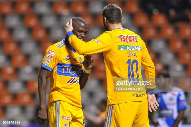 Tigres' Ecuadorean player Enner Valencia celebrates with French teammate AndrePierre Gignac after scoring against Puebla during their Mexican...