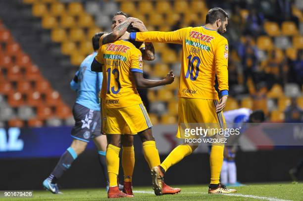 Tigres' Ecuadorean player Enner Valencia celebrates with teammates AndrePierre Gignac and Eduardo Vargas after scoring against Puebla during their...