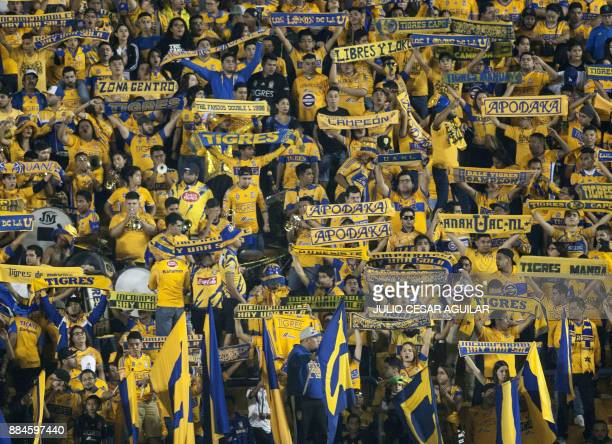 Tigres fans cheer for their team during their semifinal Mexican Apertura 2017 tournament football match against America at the Universitario stadium...