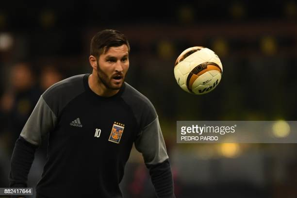 Tigres' footballer French AndrePierre Gignac warms up before the start a match against America during their Mexican Apertura 2017 tournament first...