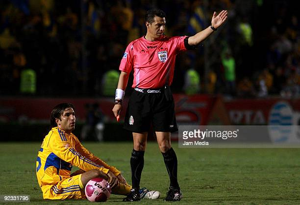 Tigres' Francisco Fonseca and Referee Armando Archundia in action during their match in the 2009 Opening tournament the Mexican Football League at...
