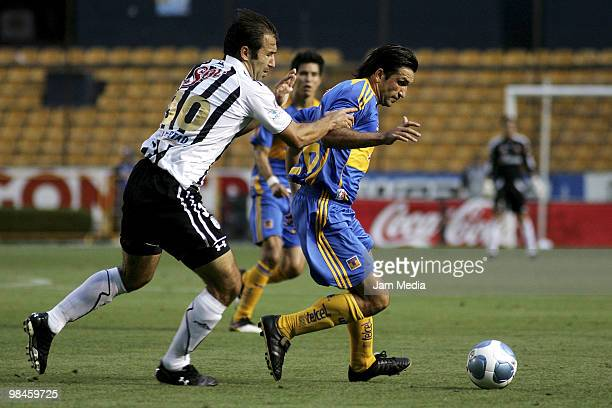Tigres' Francisco Fonseca fights for the ball with Joaquin Beltran of Queretaro in a 2010 Bicentenary Mexican Championship soccer match between...