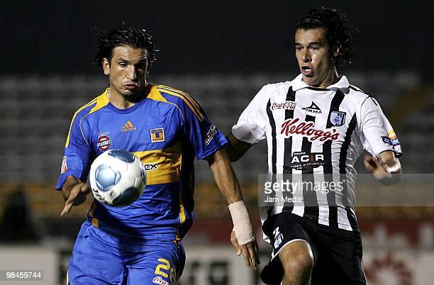 Tigres' Francisco Fonseca fights for the ball with Rodrigo Inigo of Queretaro in a 2010 Bicentenary Mexican Championship soccer match between Tigres...