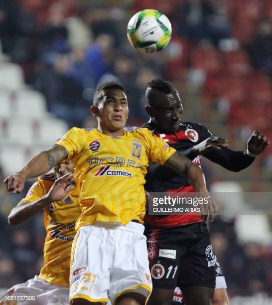 Tigres' Francisco Meza heads the ball with Tijuana's Eryc Castillo during the Mexican Clausura 2019 tournament football match between Club Tijuana...