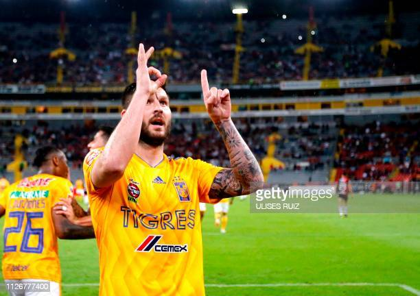 Tigres French player AndrePierre Gignac celebrates after scoring his 100th goal with Tigres during the Mexican Clausura 2018 tournament football...