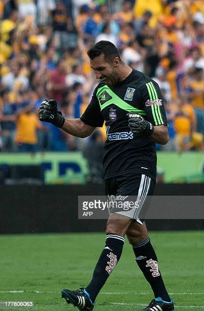 Tigres' goalkeeper Sergio Garcia celebrates after scoring against Chiapas during their Apertura 2013 Mexican tournament football match in Monterrey,...