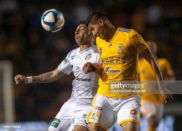 Tigres' Hugo Ayala vies for the ball with Marcelo Correa of Santos, during the Mexican Clausura 2019 tournament football match at the Universitario...