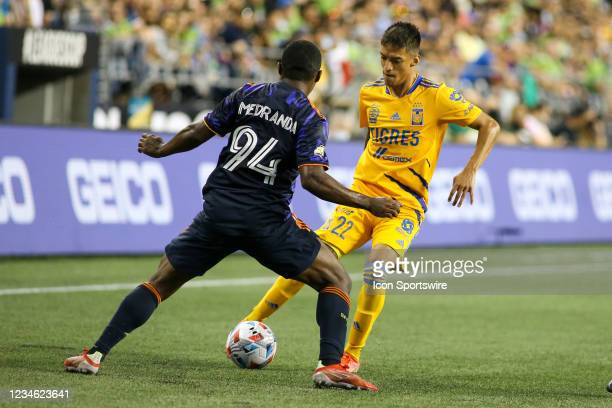 Tigres midfielder Raymundo Fulgencio tries to dribble the ball past Seattle Sounders midfielder Jimmy Medranda during the Leagues Cup Quarterfinal...