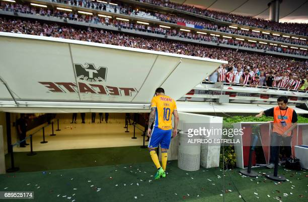 Tigres player Andre-Pierre Gignac leaves the field, refusing to receive the runner-up trophy after losing to Guadalajara during the final match of...