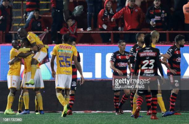 Tigres' players celebrate after scoring a goal during the Mexican Clausura 2019 tournament football match between Club Tijuana and Tigres UANL at...